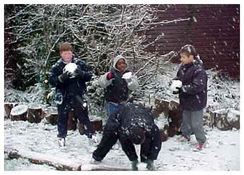 Children playing in the snow at Eveline Lowe Primary School